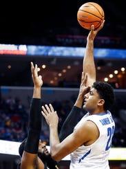 Memphis center Karim Sameh Azab puts ups a shot against