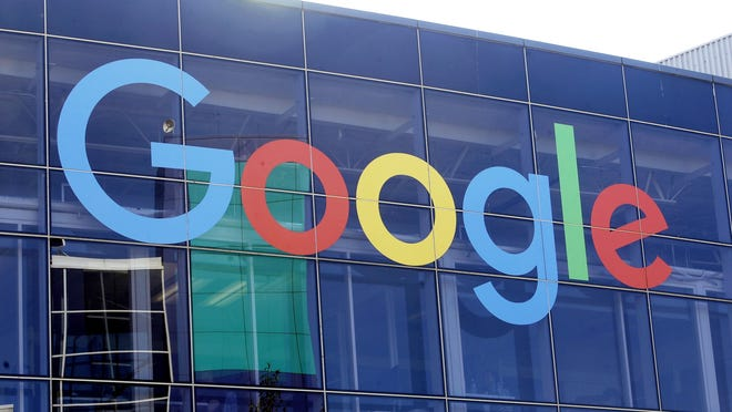 In this 2019 file photo a sign is shown on a Google building at their campus in Mountain View, Calif.