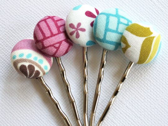 With just small circles of leftover fabric you can make colorful bobby pins.