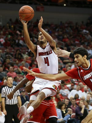 U of L's Quentin Snider (4) splits the defense including Anas Mahmoud (14) during the Red-White Scrimmage at the KFC Yum! Center.