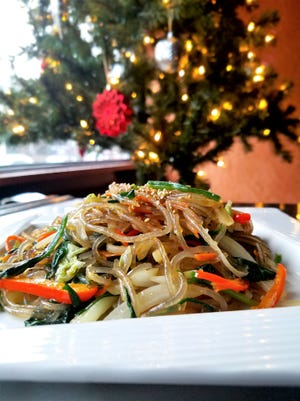 Japchae is a dish of vegetables and meat (if you wish) stir-fried with springy, clear glass noodles.