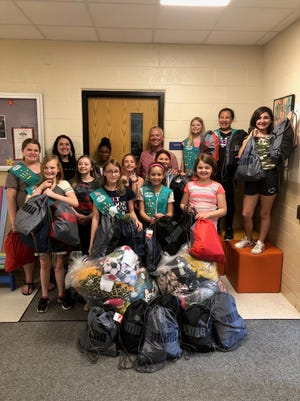 Rosenow Girl Scouts Junior Troop gave 32 welcome bags to the Pillar & Vine staff.