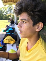 Waiting to go back onto the soccer pitch is Moustapha Lalani.