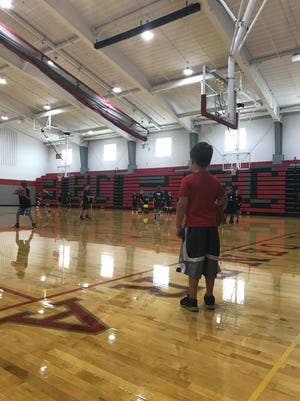 A youngster watches the Next Level Basketball 419 Camp last week at Buckeye Central High School waiting for the day he can join.