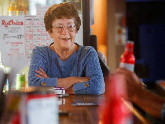 Jean Doublin, owner of Ruthie's Bar, talks with her