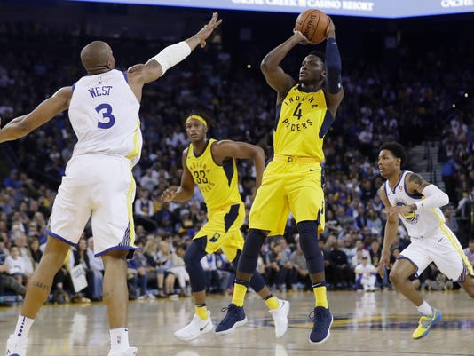 Indiana Pacers' Victor Oladipo (4) shoots over Golden State Warriors' David West (3) during the first half of an NBA basketball game Tuesday, March 27, 2018, in Oakland, Calif. (AP Photo/Marcio Jose Sanchez)