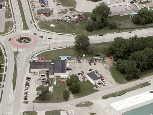 An aerial view of northeast corner of Velp Avenue and Atkinson Drive. The land north of the roundabout, right, is one of four locations that would be promoted for redevelopment under a plan to improve the Velp Avenue corridor.