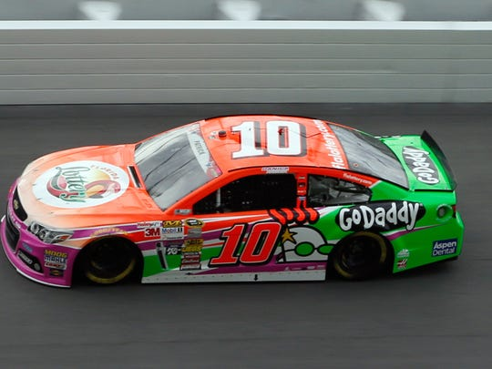 NASCAR Sprint Cup Series driver Danica Patrick (10) drives through turn four during practice for the Coke Zero 400 at Daytona International Speedway.