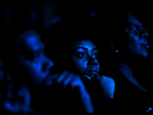 February 24, 2018 - University of Memphis student Jordyn Hooks, 18, watches Angela Rye, CNN liberal political commentator and an NPR political analyst, as she delivers a speech during the I AM A MAN Commemoration at the Orpheum Theater on Saturday morning. The event, hosted by the City of Memphis, recognized sanitation workers involved in the 1968 Sanitation Strike.