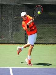 Nicolas Trullenque, from Houston, returns a ball during