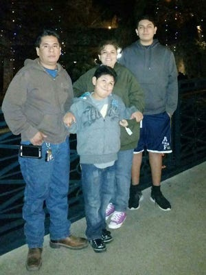 Javier Rivera, left, was struck and killed by a stray bullet on New Year's Eve.