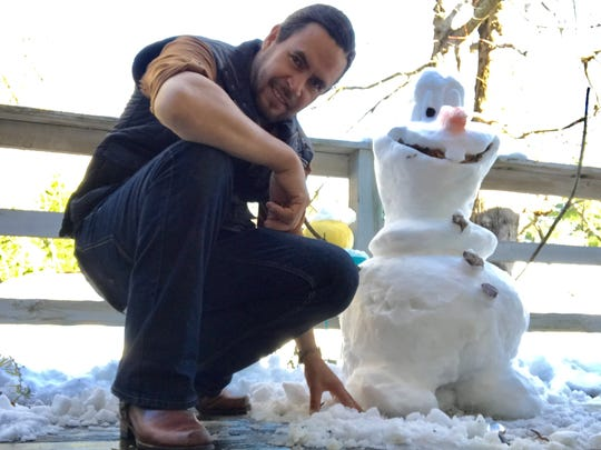 """I am Olaf, and I like warm hugs!""  So says Jaime Diaz's creation on the patio of Maple Ridge Apts. Near Dynamite Coffee in Black Mountain."