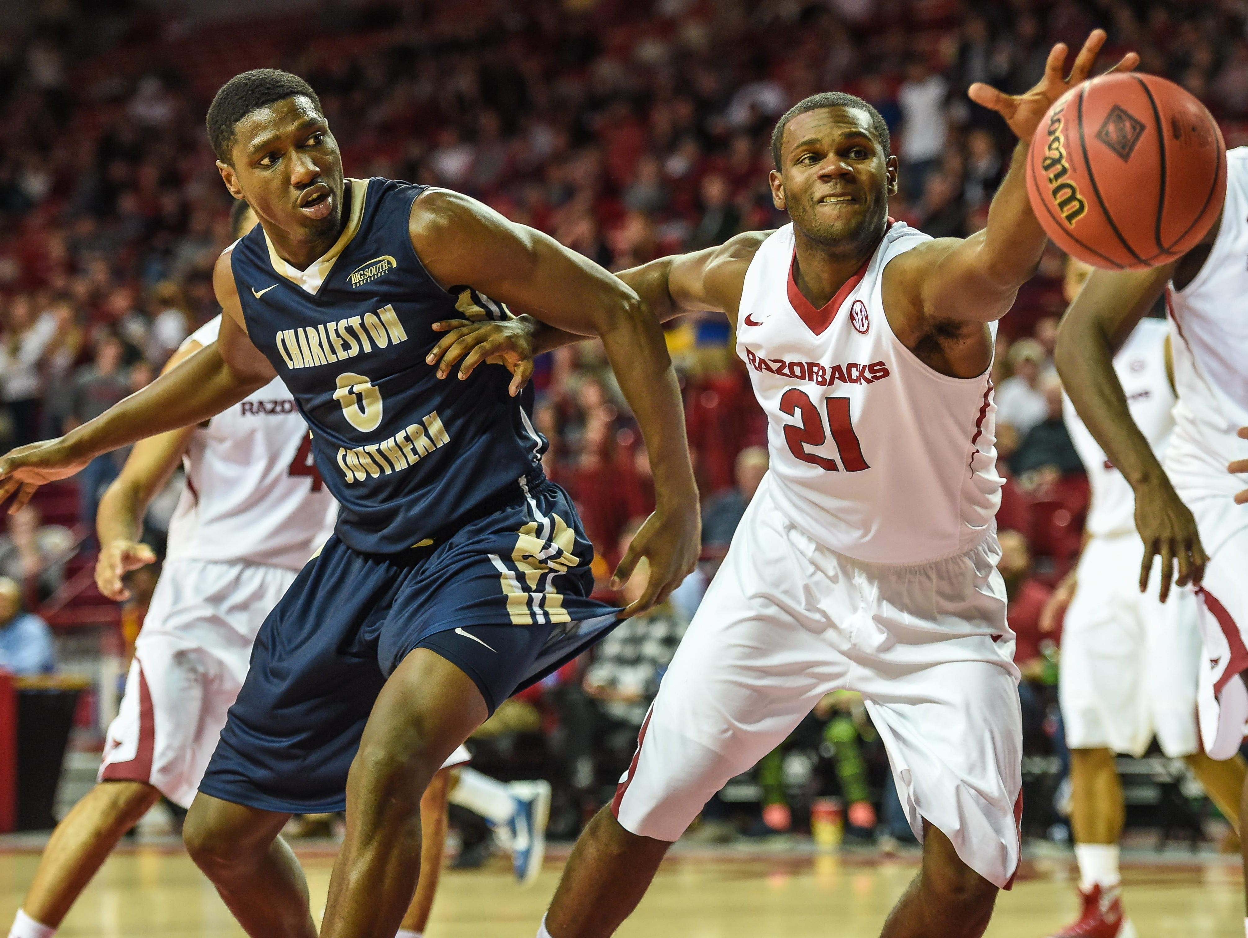 Arkansas guard Manuale Watkins (21) fights for the ball during a game between the Razorbacks and Charleston Southern on Nov. 20.