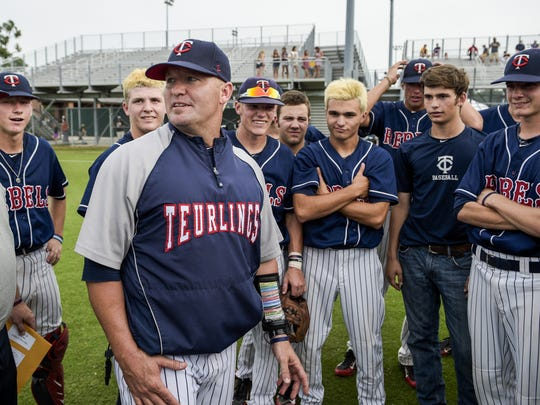 Teurlings Catholic Michael Thibodeaux speaks to players following their 16-1 victory over Tioga in an LHSAA Class 4A semi-final playoff game at McMurry Park in Sulphur, LA, Thursday, May 14, 2015. Teurlings Catholic will play in the Class 4A state final on Saturday.