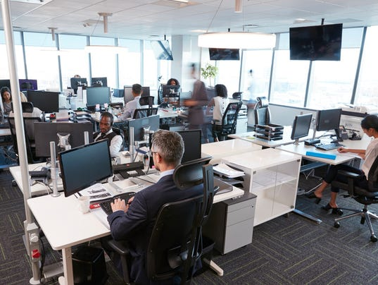 Interior Of Busy Modern Open Plan Office With Staff