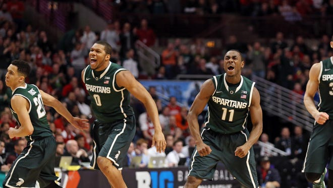 Michigan State's Marvin Clark and Lourawls (Tum Tum) Nairn were on the verge of a Big Ten tournament title, but things came crashing down quickly Sunday in Chicago.