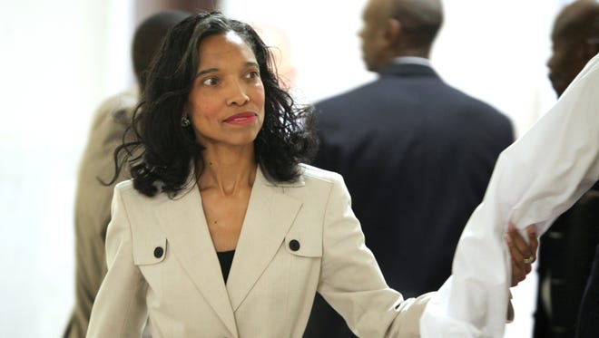 Judge Tracie Hunter walks into court on June 5 with her attorney, Clyde Bennett II.