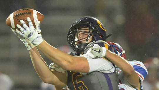 Oconomowoc's Zachary Clayton makes an over-the-shoulder