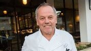 Wolfgang Puck stands outside WP Kitchen + Bar, 73130 El Paseo, in Palm Desert.