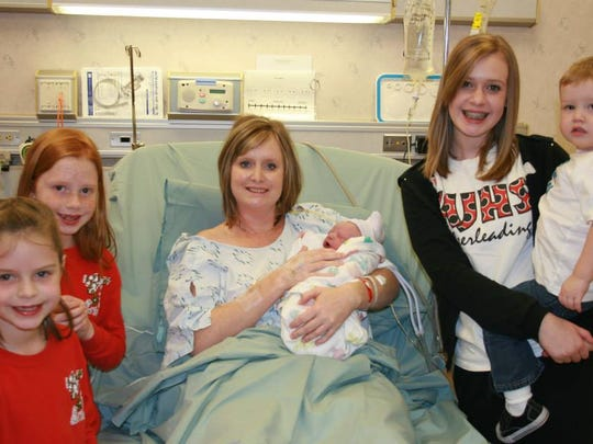 Katie Ryan holds her newborn son, Joseph, surrounded by his big brother and sisters.