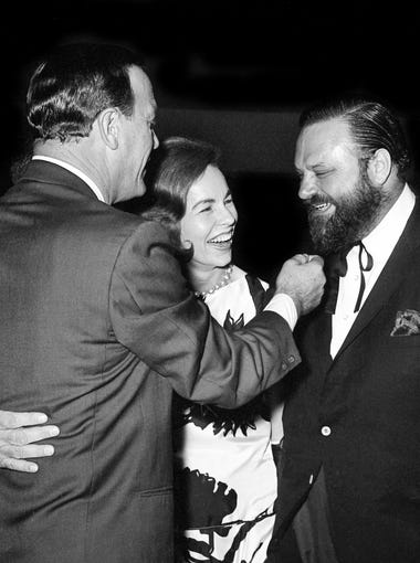 Eddy Arnold, left, Jo Walker of CMA and trumpeter Al Hirt attend the grand opening of RCA Victor's new recording center March 29, 1965. Arnold gives his fellow performer's beard a playful tug.
