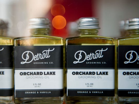 Orchard Lake grooming oil with orange and vamilla are on a shelf at  Detroit Grooming Co. in Ferndale on Thursday, Nov. 9, 2017.