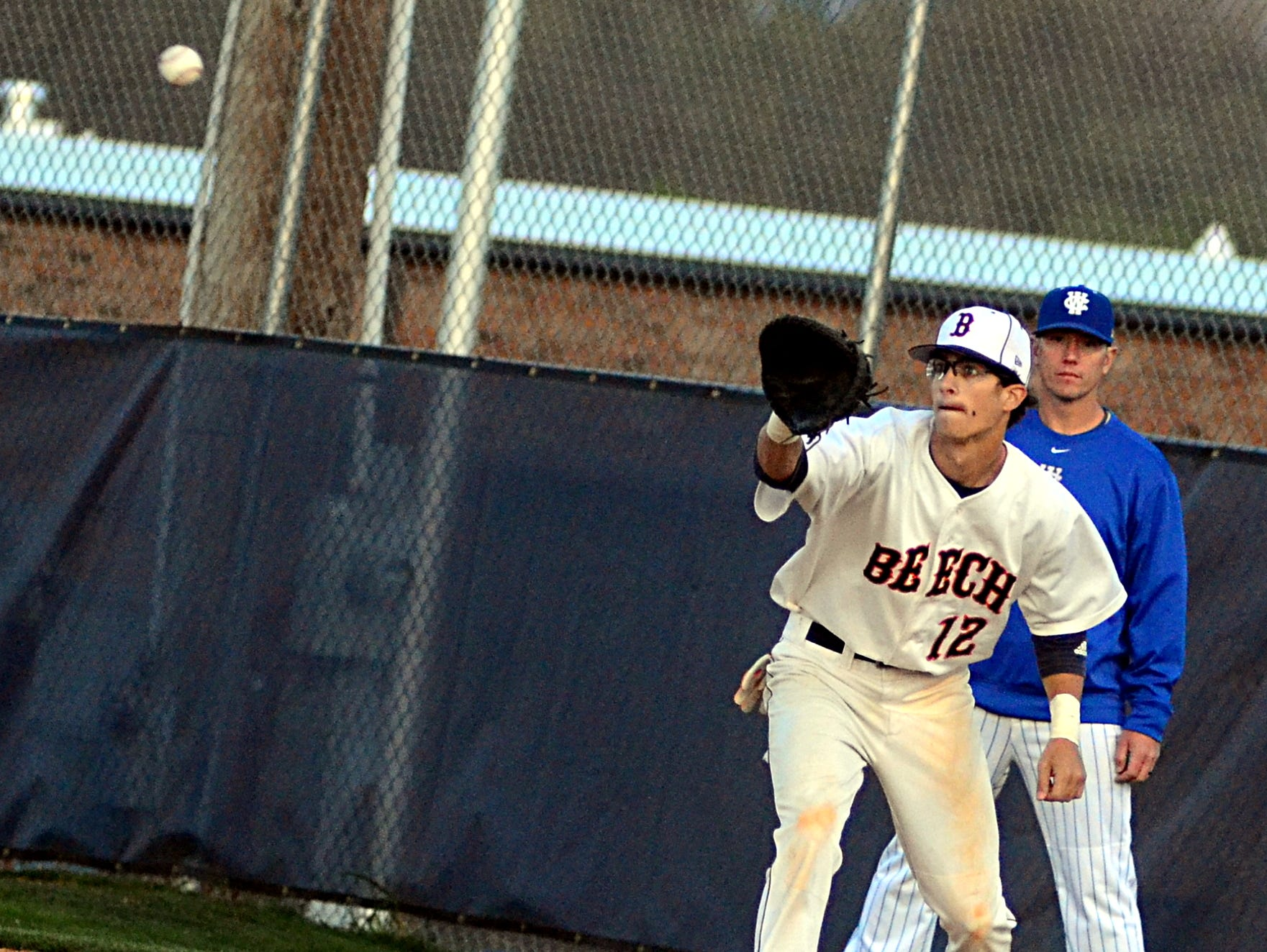 Beech High senior first baseman Jacob Jenkins receives a throw during first-inning action. Jenkins scored a run and had a stolen base in the Buccaneers' 4-2 loss.