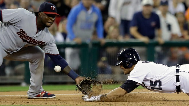 Minnesota Twins third baseman Miguel Sano misplays the relay throw and Detroit Tigers' Mikie Mahtook safely slides into third for a triple during the seventh inning of a baseball game, Saturday, Aug. 12, 2017, in Detroit. (AP Photo/Carlos Osorio)