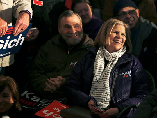Supporters of John Kasich laugh at a joke by the Ohio governor as he holds the Charleston County Town Hall at Finn's Brick Oven in Mt Pleasant, South Carolina Wednesday February 10, 2016.