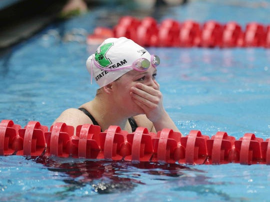 Yorktown's Emily Weiss looks at her time after completing the girls 100 yard breaststroke, during the IHSAA girls swimming state finals, held at IUPUI Natatorium, Feb. 11, 2017.
