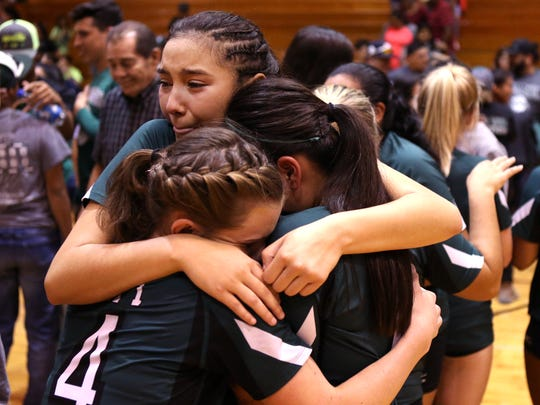 Taft Greyhound volleyball players Kelly Graves (clockwise from bottom left), Anisa Martinez, and Rhianna Ozuna hug after losing to the London Pirates in the regional quarterfinals on Monday, November 6, 2017. London won the match in three sets.