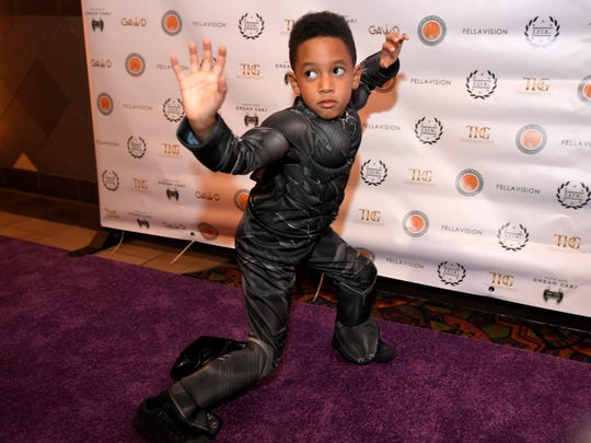 Carson Bailey, 6, dressed up as the Black Panther,