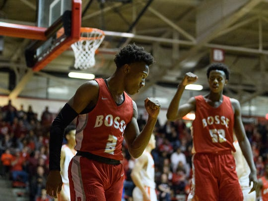 Bosse's Mekhi Lairy (2) reacts to being fouled as Bosse's Kiyron Powell (52) does the same during the IHSAA Class 3A Regional Championship against the Silver Creek Dragons at Memorial Gym in Huntingburg, Ind., Saturday, March 10, 2018. The Bulldogs claimed the regional championship title after defeating the Dragons, 81-55.