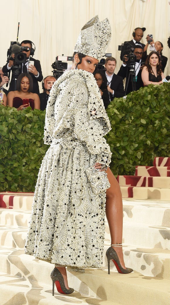 This papal outfit shows off some leg. Here's Rihanna
