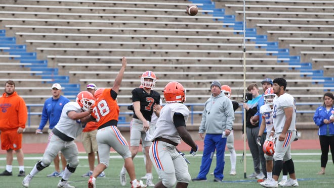Head coach Brent Davis watches San Angelo Central High School quarterback Maverick McIvor throw a pass during workouts last month. The Bobcats will hold their spring game at 6 p.m. Friday at San Angelo Stadium.