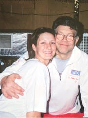 Moments before this picture was taken in 2003 in Kuwait, Stephanie Kemplin of Maineville, Ohio, says then-comedian Al Franken groped her breast.