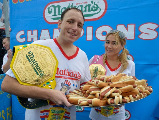 Joey Chesnut and Miki Sudo, champions of the 99th annual
