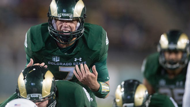 CSU quarterback Nick Stevens calls out a play before the snap in a game against Utah State at Hughes Stadium Saturday, October 8, 2016.