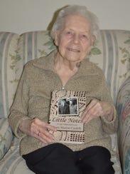 Doris Cardelli, 92, of Royal Oak with her memoir.