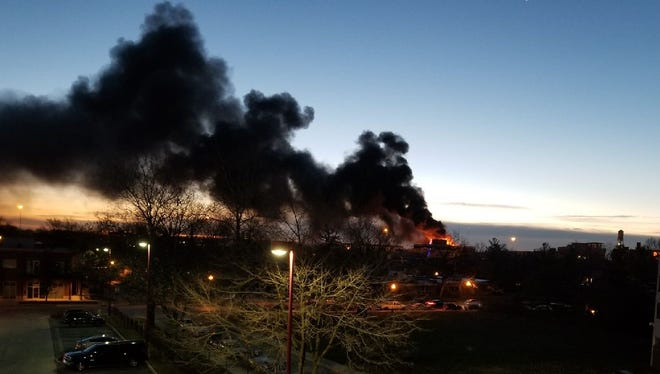 Indianapolis firefighters battled a fire at the Beilouny Buiilding at College and Massachusetts avenues shortly after 7 a.m. on Friday, Dec. 8, 2017. The fire sent smoke billowing across that part of Downtown Indianapolis.
