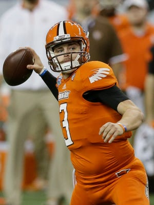 Bowling Green quarterback James Knapke throws during the first half of the Mid-American Conference championship NCAA college football game against Northern Illinois in Detroit, Friday, Dec. 5, 2014. (AP Photo/Carlos Osorio)
