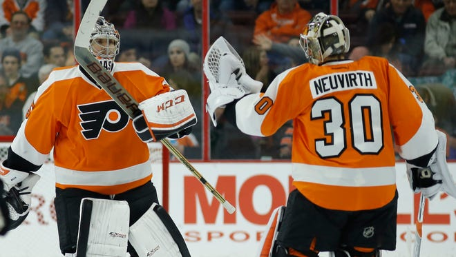 Michal Neuvirth has started the last five games for the Flyers and Steve Mason, left, is ready to get a shot.