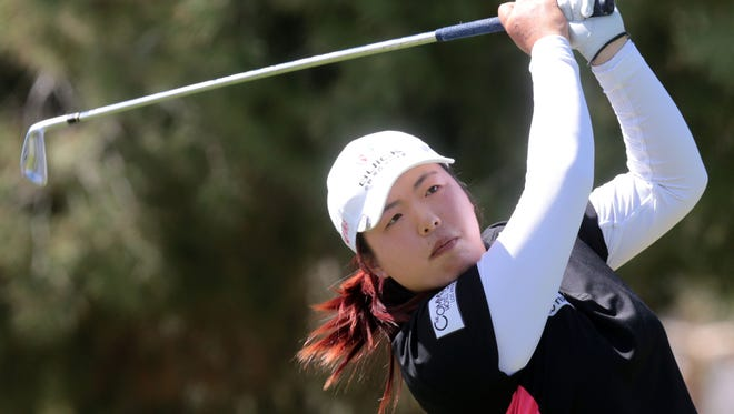 Shanshan Feng of China tees off on 17 during the first round a the 2014 Kraft Nabisco Championship on Thursday at Mission Hills Country Club in Rancho Mirage. Feng finished the day 6 under.