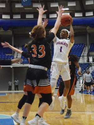 Louisiana College's Kourtney McGhee (1) shoots for two against the University of Texas Dallas during a 2018 game at the Rapides Parish Coliseum.