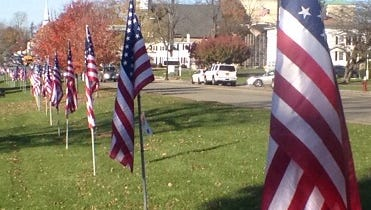 The 'Row of Honor,' a display of 100 flags set up along the shores of Lake Gleneida in Carmel, honors local veterans.