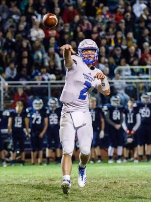 Brookfield Central quarterback Drew Leszczynski (2) delivers a pass during the game at Brookfield East on Friday, Sept. 29, 2017.