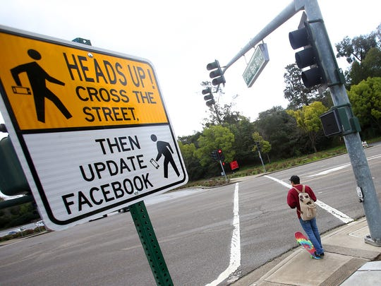 In this Feb. 9, 2015 photo, a new pedestrian crossing sign sits along Carlos Bee Boulevard in Hayward, Calif. The city is using humor to get drivers to slow down and pedestrians to pay attention. (AP Photo/The Contra Costa Times, Aric Crabb)