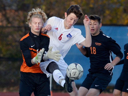Fairport's Nick Guida, center, collides with Bethlehem
