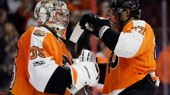 Philadelphia Flyers' Steve Mason, left, and Wayne Simmonds celebrate after an NHL hockey game against the Colorado Avalanche, Tuesday, Feb. 28, 2017, in Philadelphia. Philadelphia won 4-0. (AP Photo/Matt Slocum)