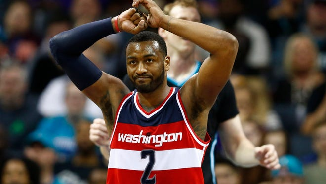 Washington Wizards guard John Wall (2) reacts after a turnover in the second half against the Charlotte Hornets at Spectrum Center. The Hornets defeated the Wizards 98-93.